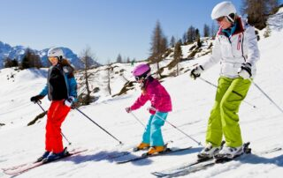 family skiing in protective gear preventing concussions winter sports winter weather
