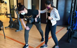 exercise programs after brain injury exercise physiologist Shriya Maharaj with client Propel Physiotherapy